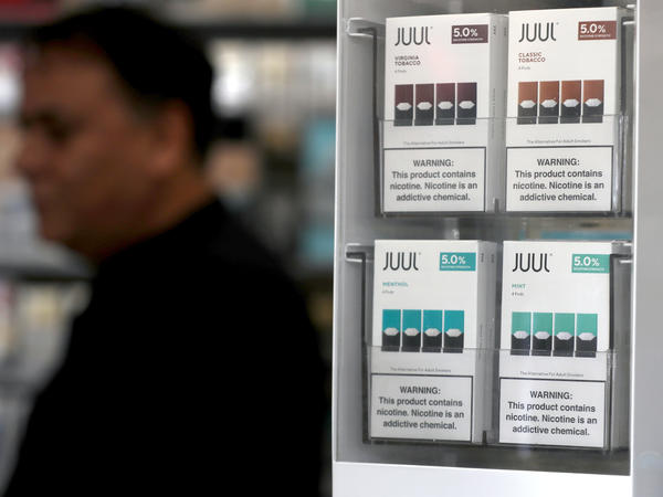 Packages of Juul mint-flavored electronic cigarettes are displayed at San Rafael Smoke Shop in 2019 in San Rafael, Calif.