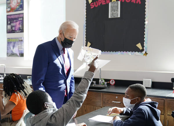 President Biden tours Brookland Middle School in Washington, D.C., on Friday. Biden has encouraged school districts to promote vaccines to protect students as they return to school amid a coronavirus resurgence.