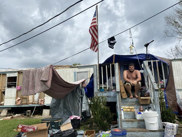 Jayce Marcel in a makeshift tent constructed in front of his damaged mobile home in the Ashland South community between Houma and Dulac.