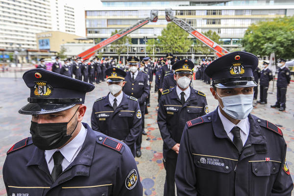 Members of the Berlin city fire department attend a ceremony Saturday near the Breitscheidplatz memorial to commemorate fellow firefighters and other victims killed in the 9/11 terror attacks in New York City.