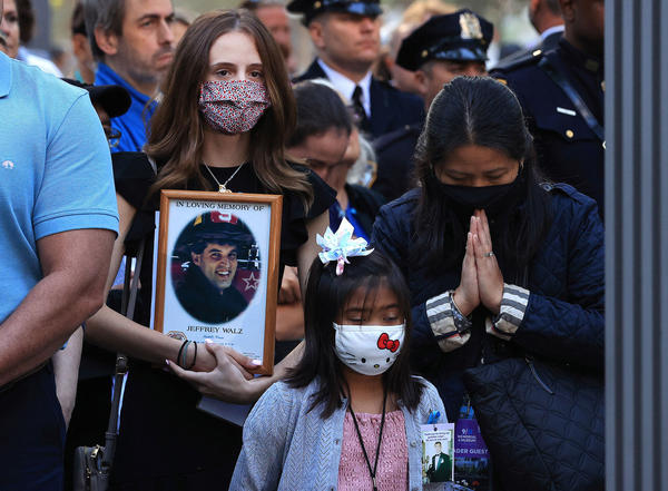 Family members and loved ones of victims of those who died on 9/11 attend the 20th anniversary commemoration ceremony on Saturday at the National September 11 Memorial & Museum in New York City.