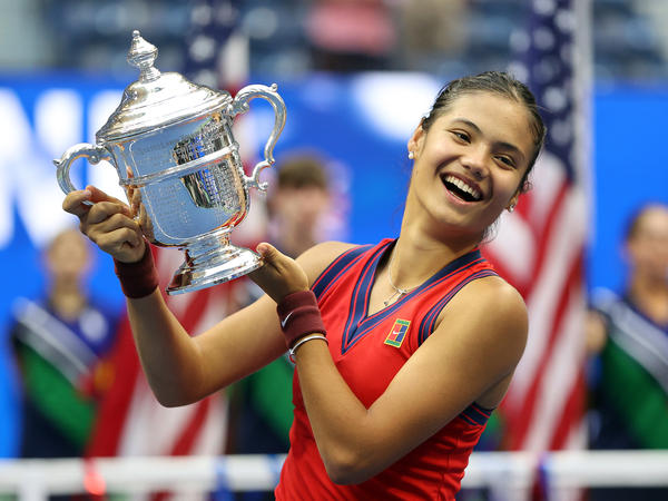 Emma Raducanu of Great Britain celebrates with the championship trophy after defeating Leylah Annie Fernandez of Canada during their women's singles final match on Day 13 of the 2021 US Open on Saturday.