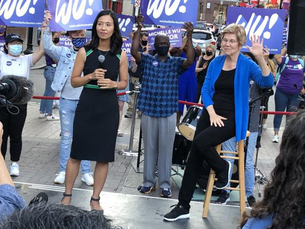 City councilor and mayoral candidate Michelle Wu was joined by Sen. Elizabeth Warren at a rally in Chinatown on Saturday. (Anthony Brooks/WBUR)