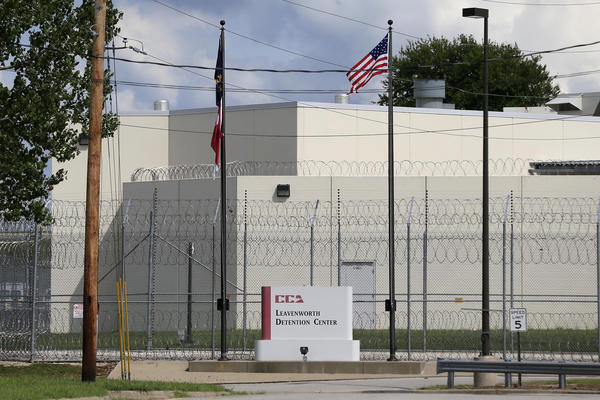 The main gate of the privately run Leavenworth Detention Center in 2016. At the time, the prison's operator was known as the Corrections Corporation of America but has since been renamed CoreCivic. Legal advocates are hoping the facility shuts down when its federal contract ends at the end of 2021.