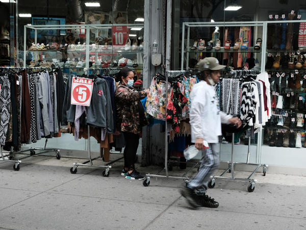 People shop in the Brooklyn borough of New York City in May. Poverty declined in 2020, according to the U.S. Census Bureau's Supplemental Poverty Measure.