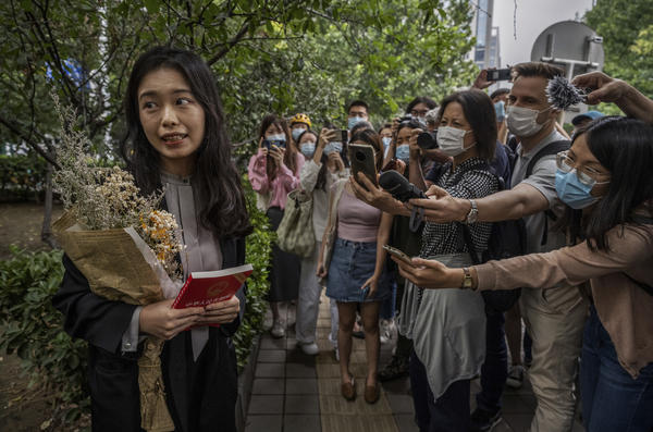 Zhou Xiaoxuan speaks to journalists and supporters on Sept. 14 outside the Haidian District People's Court in Beijing before a hearing in her case. She alleged that she was groped and forcibly kissed by prominent TV anchor Zhu Jun, who denies the allegations and has countersued for defamation. The court ruled there was not sufficient evidence of sexual harassment.