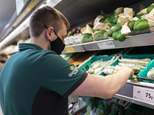A staff member sorts through fresh produce at British supermarket chain Morrisons last month in Leeds, United Kingdom.