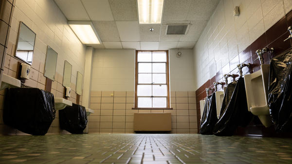School administrators and police are warning parents about a trend in which students destroy objects in school bathrooms for attention on social media.