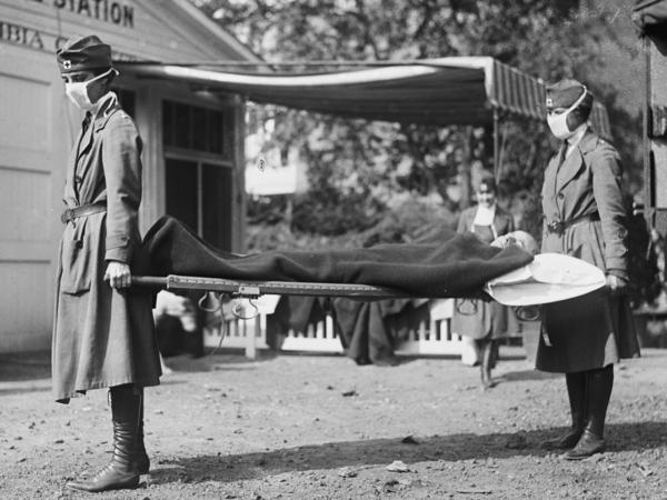 This photo made available by the Library of Congress shows a demonstration at the Red Cross Emergency Ambulance Station in Washington during the influenza pandemic of 1918.