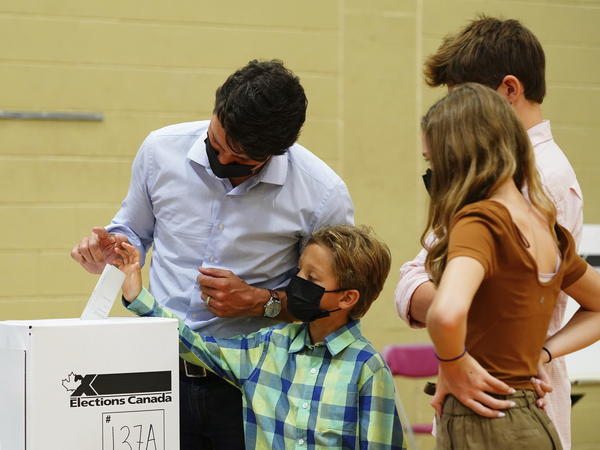 Liberal leader Justin Trudeau casts his ballot in the 44th general federal election. He's joined by his children, Xavier, Ella-Grace and Hadrien in Montreal on Monday.