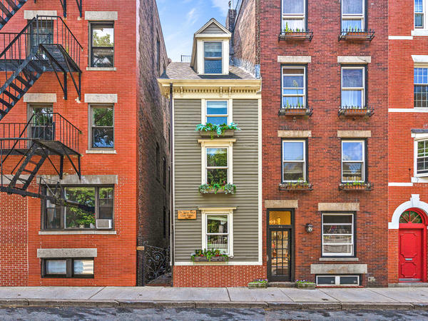 """The """"Skinny House"""" or the """"Spite House"""" is 10 feet wide at its widest. It's been sold for $1.25 million."""