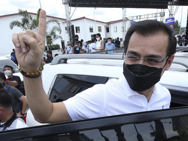 Manila City Mayor Isko Moreno gestures after declaring his bid to run for president in a speech at a public school in the slum area near the place where he grew up in Manila, Philippines on Wednesday Sept. 22, 2021.