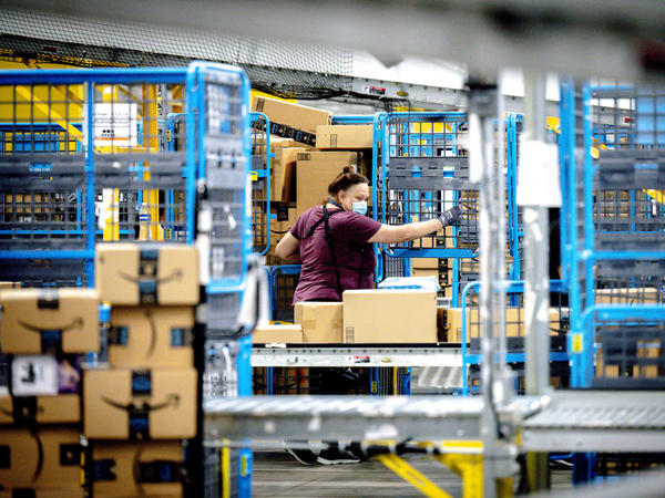 A worker sorts parcels in the outbound dock at Amazon fulfillment center in Eastvale, Calif., last month.