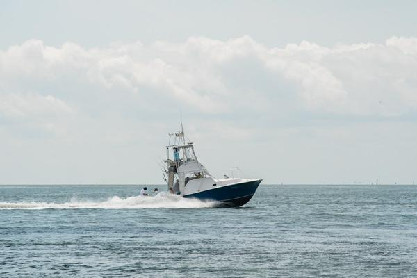 A recreational fishing boat cruises along Croatan Sound, west of Oregon Inlet, in late July.