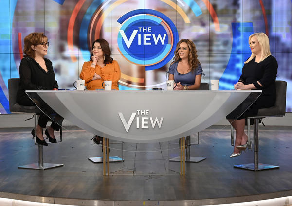 Ana Navarro (center left) and Sunny Hostin (center right) appear on <em>The View</em> on Aug. 2, 2019. The two were pulled live from the TV show on Friday, just before Vice President Harris was scheduled to join them onstage for an interview.