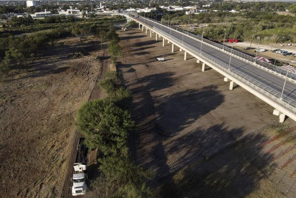 An area where migrants, many from Haiti, were encamped is seen after crews cleared the zone along the Del Rio International Bridge on Saturday in Del Rio, Texas.