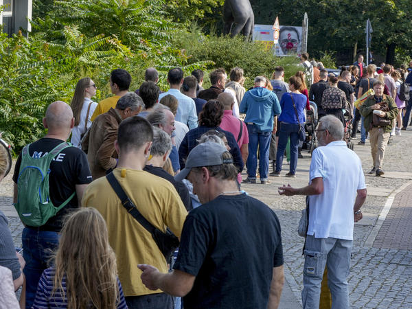 People queue in front of a polling station in the Moabit district of Berlin, Germany. German voters are choosing a new parliament in an election that will determine who succeeds Chancellor Angela Merkel after her 16 years at the helm of Europe's biggest economy.