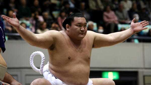 Sumo Grand Champion Hakuho performs Dohyo-iri, the ring-entering ceremony, during the Grand Sumo Tournament at the Himeji Chuo Gymnasium, in March 2015, in Himeji, Japan.