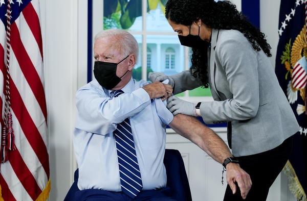 President Biden receives a COVID-19 booster shot during an event at the White House Monday.