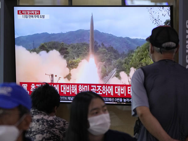 People watch a TV showing a file image of North Korea's missile launch during a news program at the Seoul Railway Station in Seoul, South Korea, Tuesday, Sept. 28. North Korea on Tuesday fired a suspected ballistic missile into the sea, Seoul and Tokyo officials said, the latest in a series of weapons tests by Pyongyang.