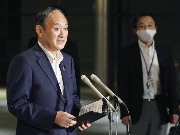Japanese Prime Minister Yoshihide Suga speaks to reporters about lifting of a state of emergency at his official residence in Tokyo Monday, Sept. 27. Suga announced Tuesday a lifting of the ongoing coronavirus state of emergency and less-stringent measures in all 27 prefectures including Tokyo when they expire at the end of September.