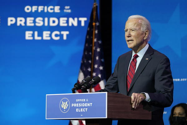 President-elect Joe Biden speaks during an event at The Queen theater in Wilmington, Del., Tuesday, Dec. 8, 2020, to announce his health care team. Vice President-elect Kamala Harris listens at right. (Susan Walsh/AP)