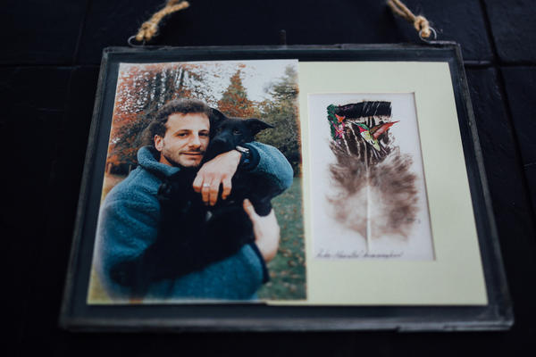 A photo of Richard Guadagno hugging his dog Raven hangs in his sister Lori's home. He died when United Airlines Flight 93 crashed outside Shanksville, Pa., on Sept. 11, 2001.