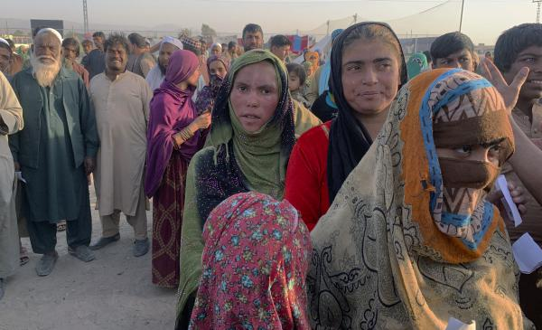 Afghan families gather after leaving their homeland and reaching the Pakistan side of the border, near the town of Chaman on Tuesday. Pakistan and other countries bordering Afghanistan have mostly closed their borders to Afghan refugees, with some exceptions.