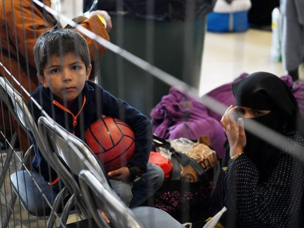 Afghan refugees wait to be processed Sept. 8 inside Hangar 5 at Ramstein Air Base in Germany.