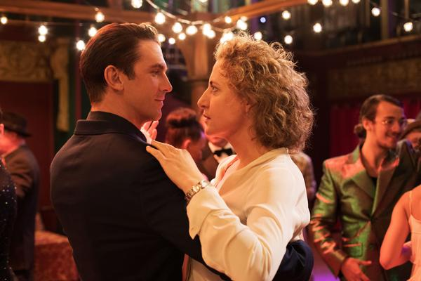 Tom (Dan Stevens) whisks a very skeptical Alma (Maren Eggert) around the dance floor as his precision-tooled algorithm tries to meet her every requirement for the perfect man.