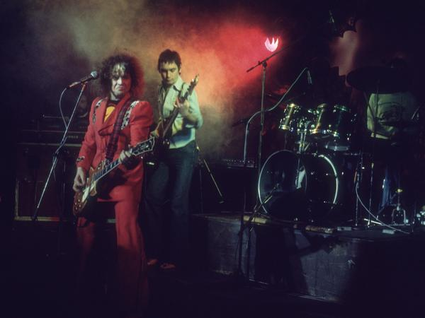 Glam rock star Marc Bolan and bassist Steve Curry perform at the Lyceum Theatre in London.