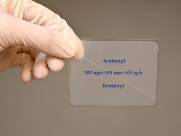 A patch containing the active ingredient fentanyl is shown by a pharmacist. The painkiller fentanyl, which can be up to 100 times stronger than heroin, is a growing cause of overdose deaths in the U.S., according to the DEA.