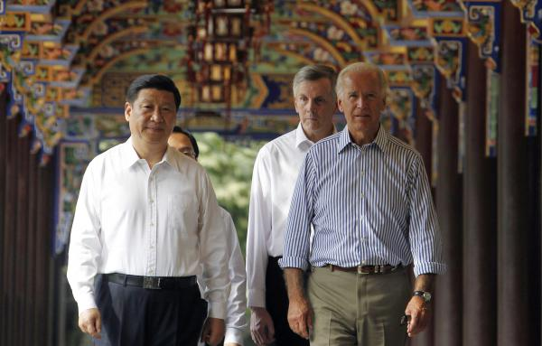 In this 2011 photo, then-U.S. Vice President Joe Biden walks with then-Chinese Vice President Xi Jinping in southwestern China. Both are now presidents of their countries at a time when U.S.-China relations have been growing increasingly tense.