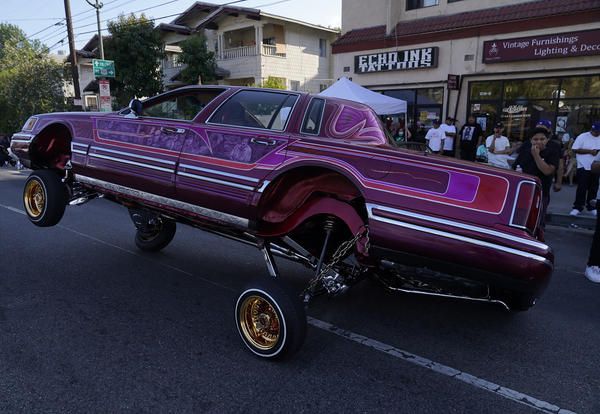 A Lowrider rides on three-wheels on Sunset Blvd., in the Echo Park neighborhood of Los Angeles in July.