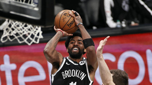 Brooklyn Nets guard Kyrie Irving shoots against the Milwaukee Bucks during Game 1 of an NBA basketball second-round playoff series in New York in June.