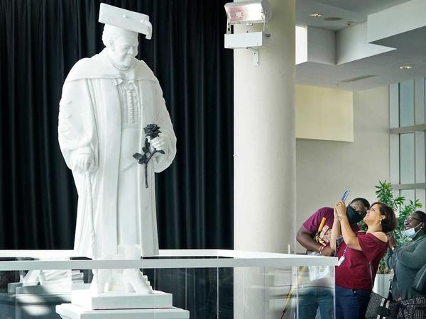 Members of the public view the newly unveiled statue of Mary McLeod Bethune at the News-Journal Center in Daytona Beach on Oct. 12. It's slated to move to the U.S. Capitol's National Statuary Hall early next year.