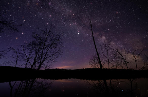 A scenic view of a lake against the sky at night in British Columbia. Earlier this month, a resident of Golden, B.C., woke up to the sound of a crash and found that a meteorite had landed in her bed.