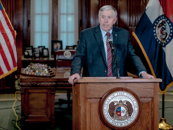 Missouri Gov. Mike Parson, pictured here at a news conference in May 2019, said on Thursday that his administration is pursuing the prosecution of a local newspaper reporter who alerted the government to website security flaws.