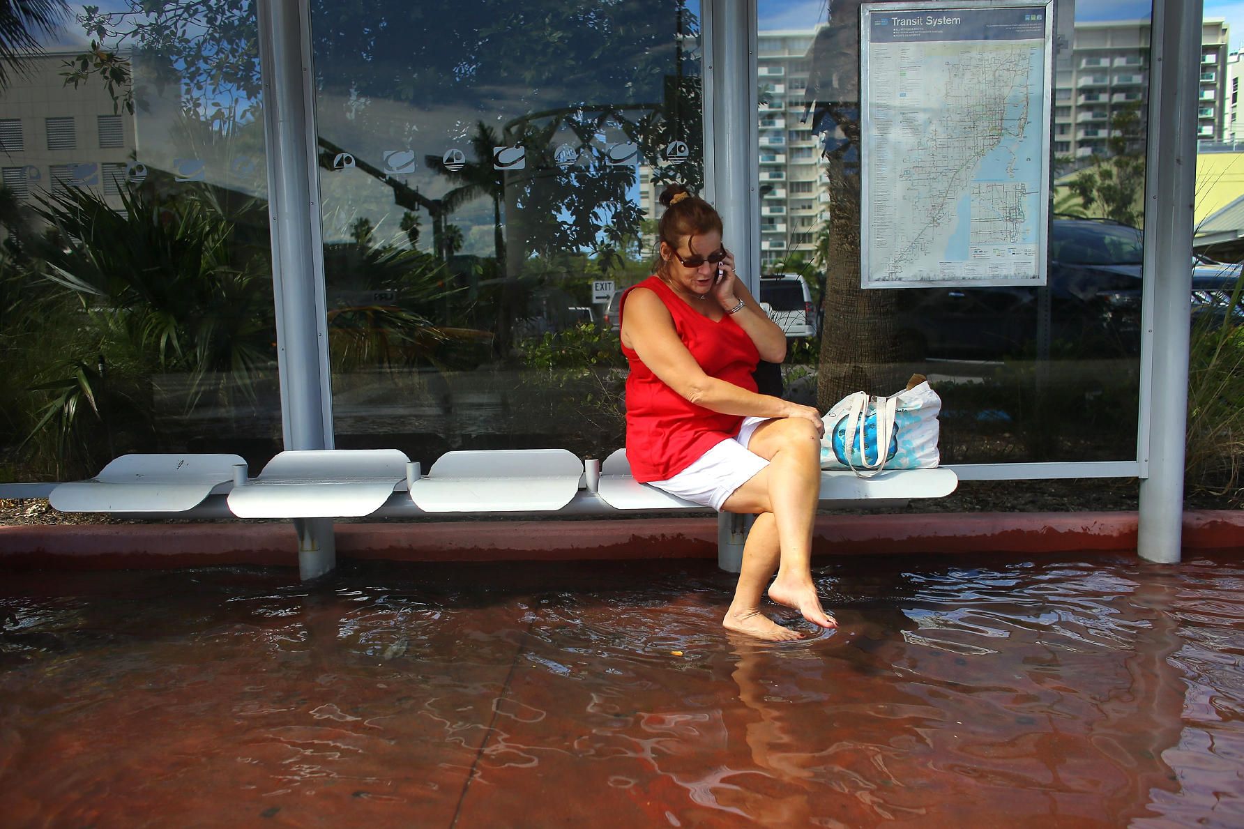 Cindy Minnix Waits For A Bus In Flooded Street On Oct 18 2017 Miami Beach Changing Climate Is Making Floods Related To High Tides More Frequent