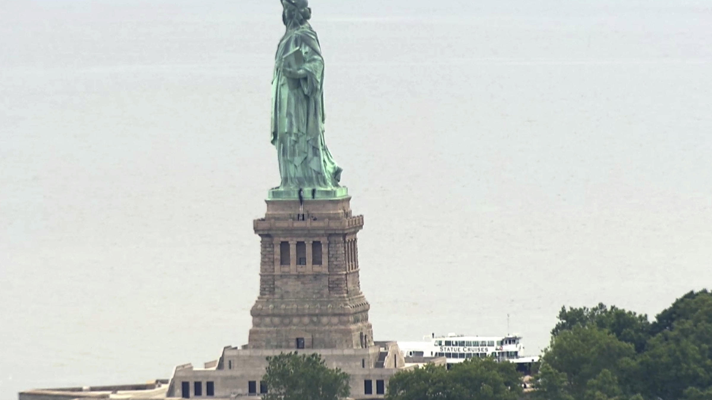 family looking at statue of liberty