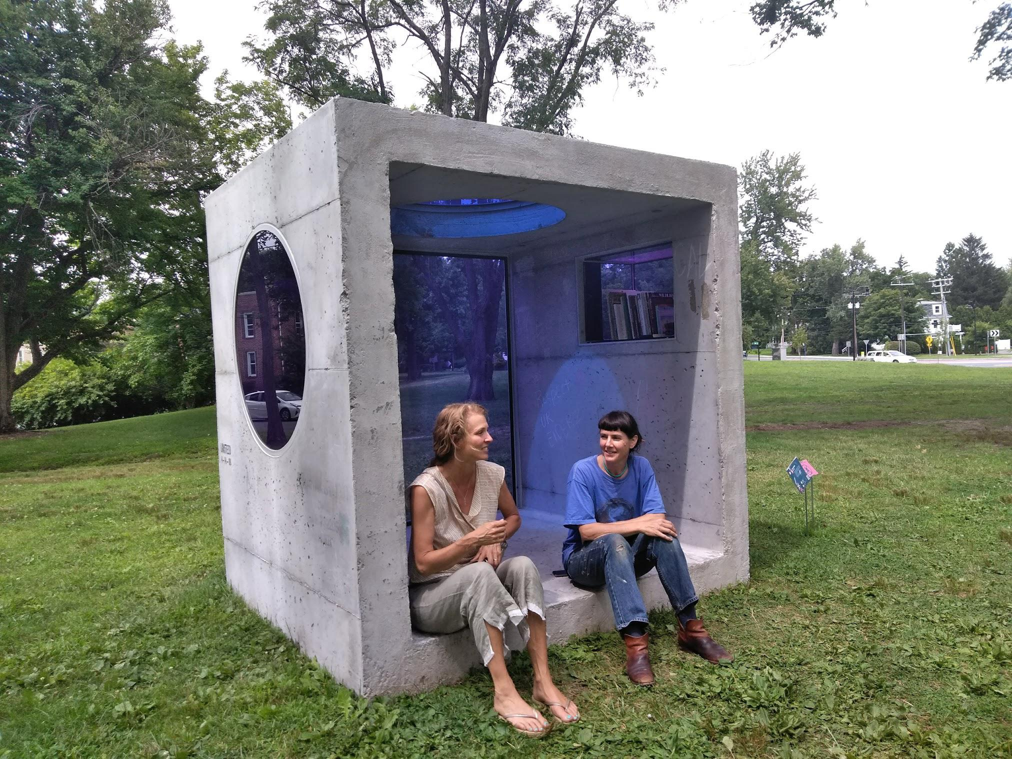 "Curator Sandy Litchfield, at left, and artist Sarah Braman sit inside Braman's ""Day Trip"" in Amherst, Massachusetts."