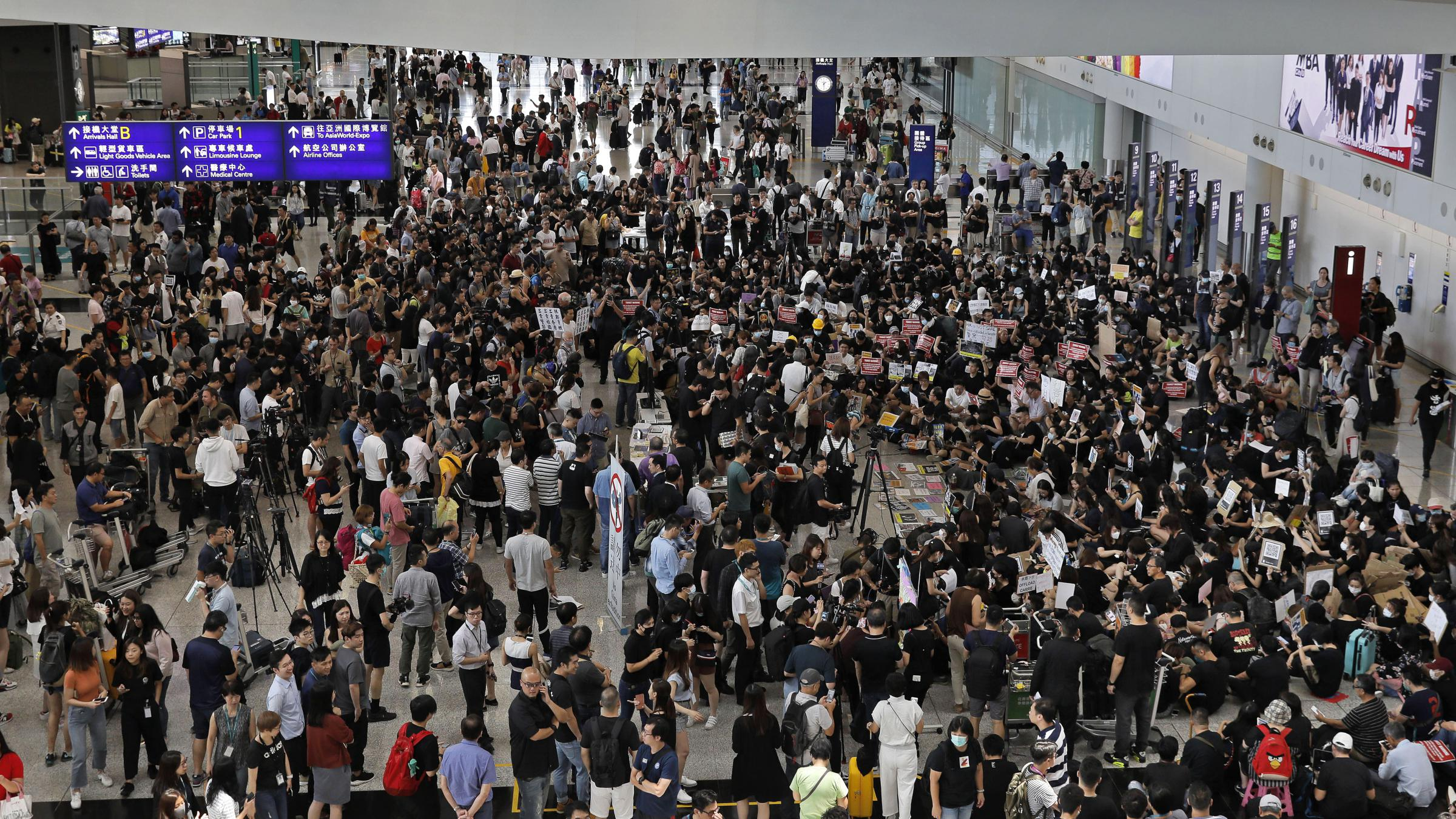 Hong Kong Protesters Occupy The City's Airport In 'Summer Of
