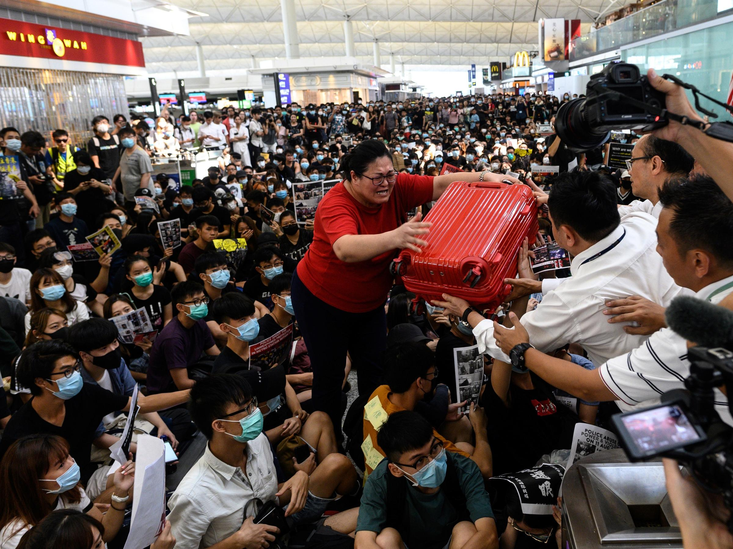 Protesters Return To Hong Kong's Airport, Causing Flight