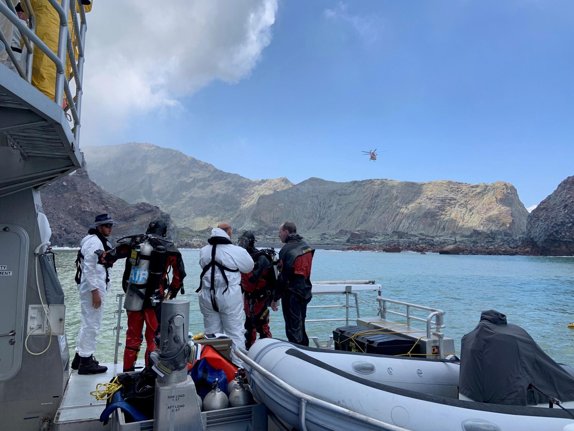 Divers Search Contaminated Water For Body Of New Zealand Volcano Victim