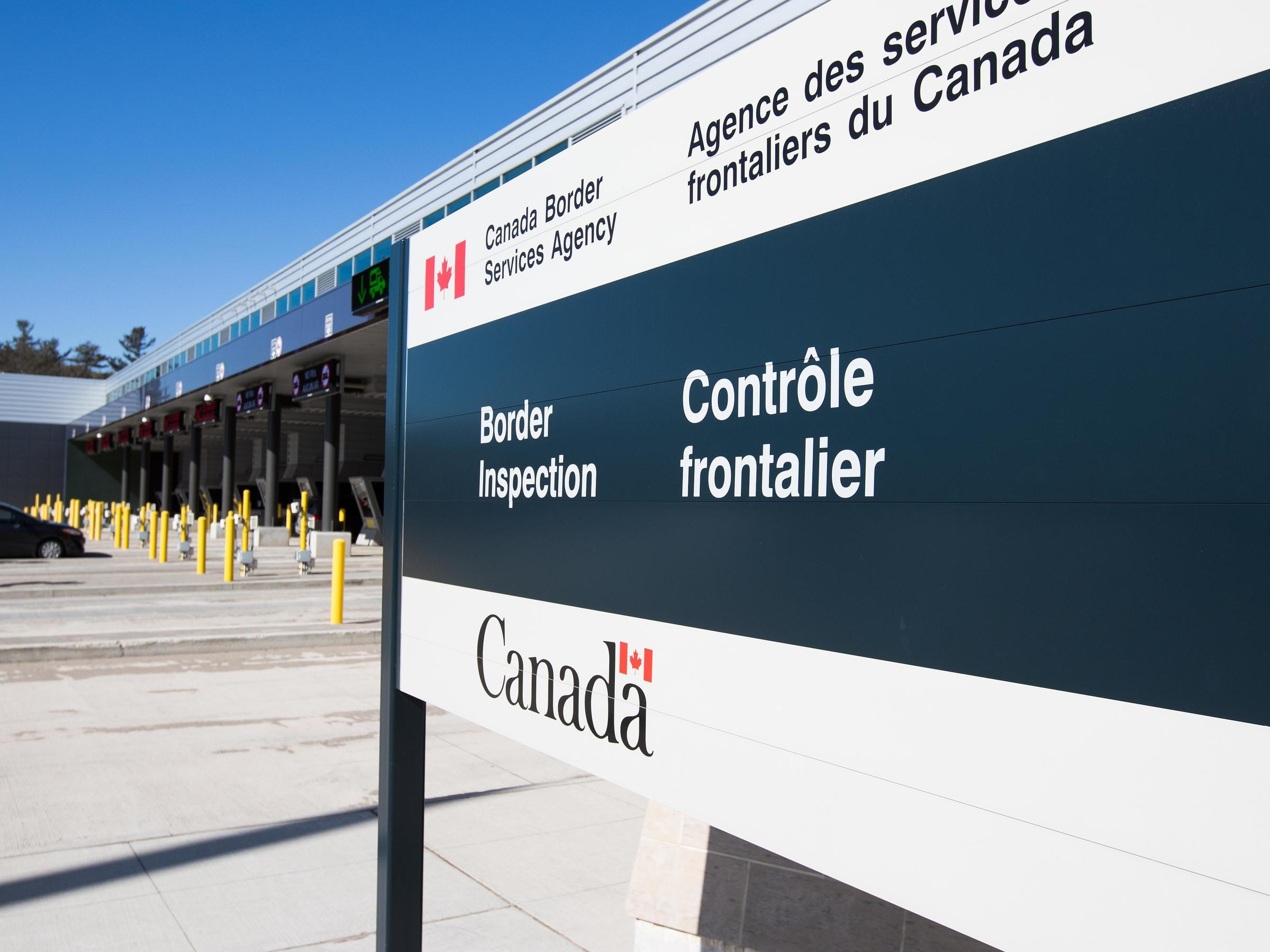 A vehicle enters a Canadian border station at the U.S./Canada border after the two countries closed their border for all non-essential travel in Lansdowne Ontario