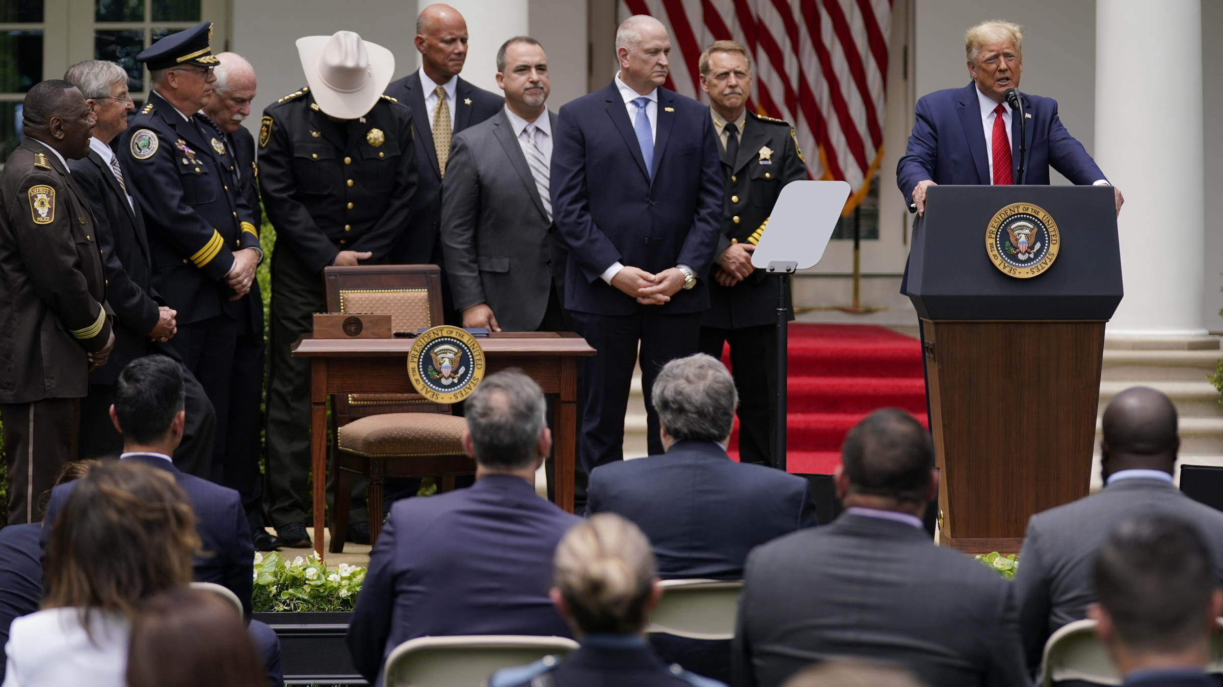 Trump Hailing Law Enforcement Signs Executive Order Calling For Police Reform Wbfo