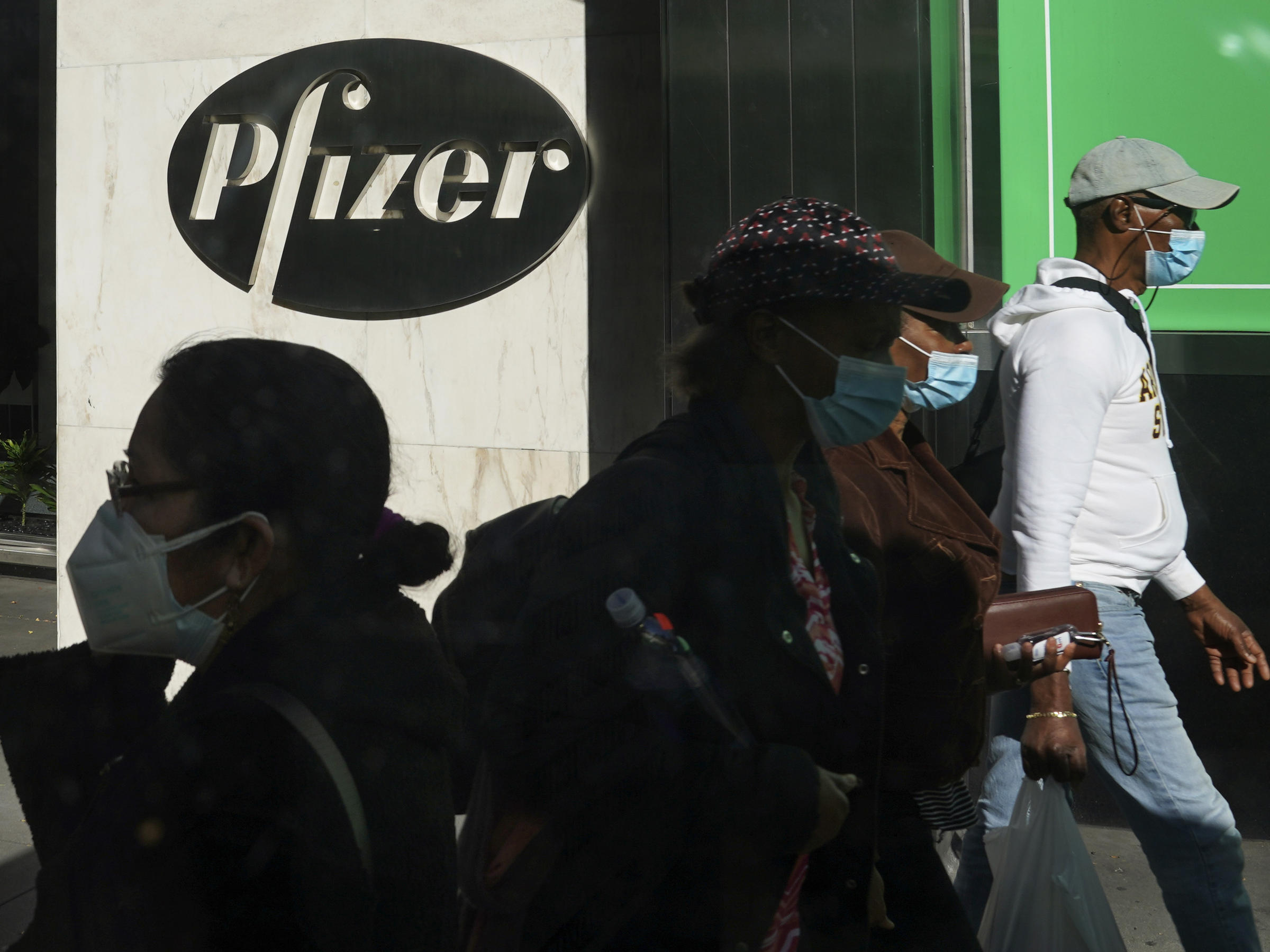 Pfizer plans to file within days with the Food and Drug Administration to allow emergency use of its COVID-19 vaccine