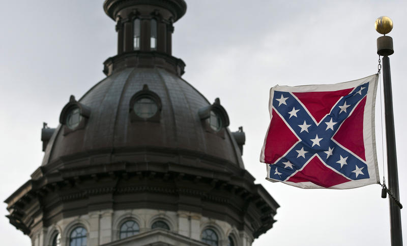 <p>A Confederate flag flies outside the South Carolina State House in Columbia, South Carolina.</p>