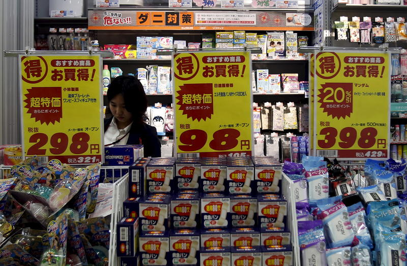 <p>A shopper is seen at a drug store in Tokyo. Chances are that this store will play Auld Lang Syne to alert shoppers that it's closing time.</p>