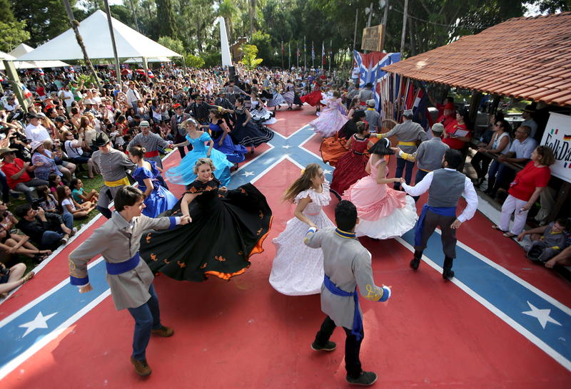 <p>Descendants of American Southerners wearing Confederate-era dresses and uniforms dance during a party to celebrate the 150th anniversary of the end of the American Civil War in Santa Barbara D'Oeste, Brazil, April 26, 2015.</p>